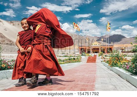 Thiksey village in Ladakh India - AUGUST 20: Two little boys monks stepping and smiling in Thiksey Monastery on August 20 2016 in Thiksey village in Ladakh India