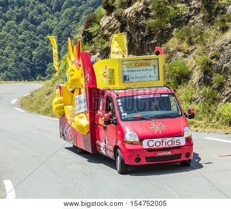 Col D'AspinFrance- July 15 2015: Cofidis Vehicle during the passing of the Publicity Caravan on the Col d'Aspin in Pyerenees Mountains in the stage 11 of Le Tour de France 2015. Cofidis is an important French money lending company.