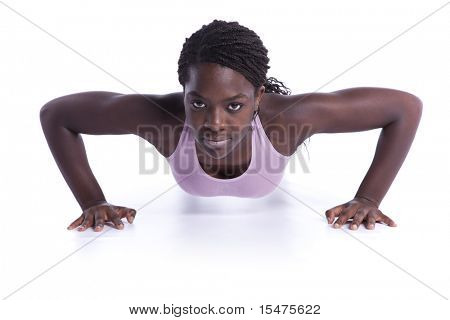 young african woman doing some push-ups (isolated on white)