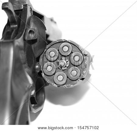 Revolver with bullets close-up isolated on white background / black and white photo in a retro style