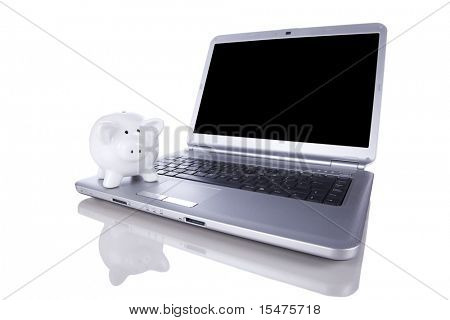 Piggy bank over a modern laptop, the cost of technology and information (isolated on white)