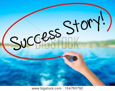 Woman Hand Writing Success Story! With A Marker Over Transparent Board