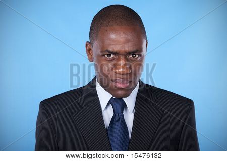 african businessman with a evil and powerful look
