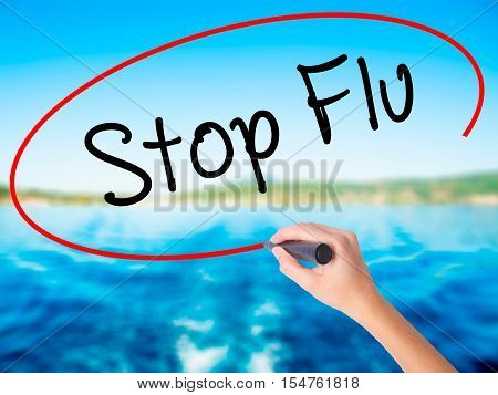 Woman Hand Writing Stop Flu With A Marker Over Transparent Board