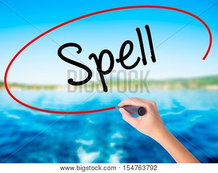Woman Hand Writing Spell With A Marker Over Transparent Board