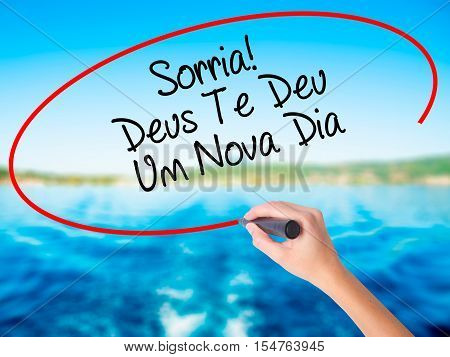 Woman Hand Writing Sorria! Deus Te Deu Um Novo Dia (smile! God Gives You Another Day In Portuguese)