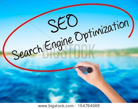 Woman Hand Writing Seo Search Engine Optimization With A Marker Over Transparent Board