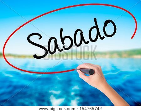 Woman Hand Writing Sabado (saturday In Spanish/portuguese) With A Marker Over Transparent Board