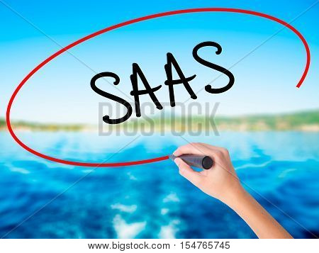 Woman Hand Writing Saas With A Marker Over Transparent Board