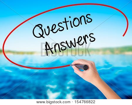 Woman Hand Writing Questions Answers With A Marker Over Transparent Board