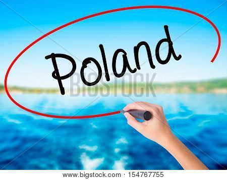 Woman Hand Writing Poland  With A Marker Over Transparent Board
