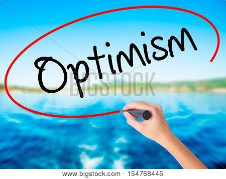 Woman Hand Writing Optimism  With A Marker Over Transparent Board