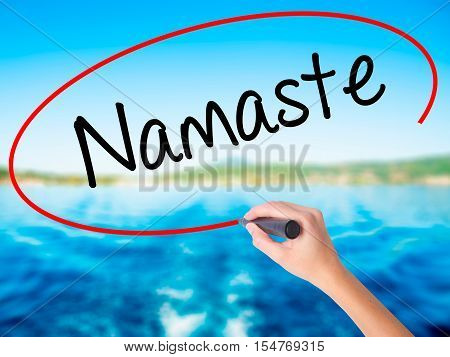 Woman Hand Writing Namaste With A Marker Over Transparent Board