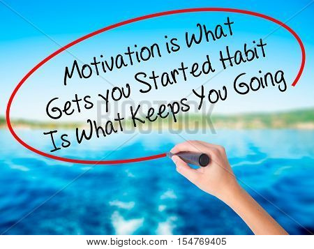 Woman Hand Writing Motivation Is What Gets You Started Habit Is What Keeps You Going With A Marker O