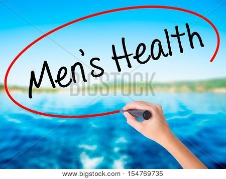 Woman Hand Writing Men's Health With A Marker Over Transparent Board