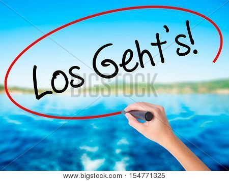 Woman Hand Writing Los Geht's! (here We Go In German) With A Marker Over Transparent Board