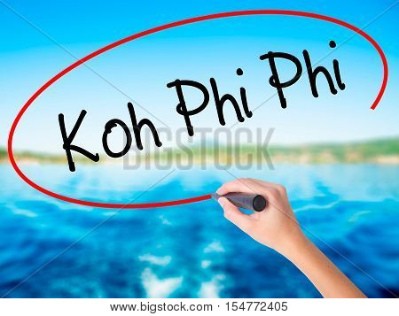 Woman Hand Writing Koh Phi Phi With A Marker Over Transparent Board.