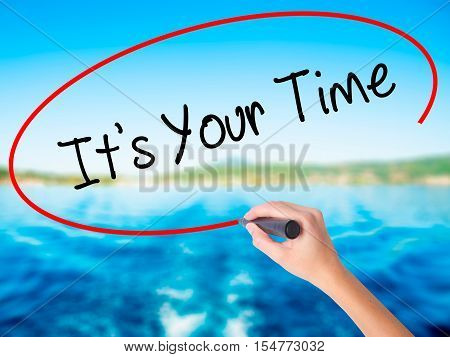 Woman Hand Writing It's Your Time With A Marker Over Transparent Board