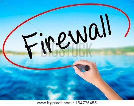 Woman Hand Writing Firewall  With A Marker Over Transparent Board