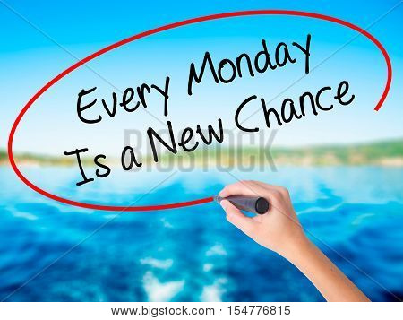 Woman Hand Writing Every Monday Is A New Chance With A Marker Over Transparent Board