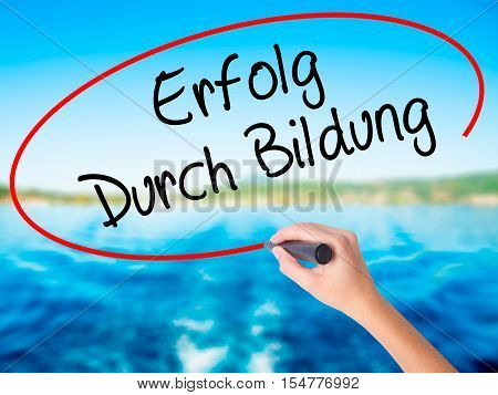 Woman Hand Writing Erfolg Durch Bildung  (success Through Training In German) With A Marker Over Tra