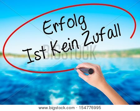 Woman Hand Writing Erfolg Ist Kein Zaufall (success Is No Accident In German) With A Marker Over Tra