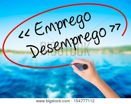 Woman Hand Writing Emprego Desemprego (employment - Unemployment In Portuguese)  With A Marker Over