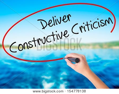 Woman Hand Writing Deliver Constructive Criticism With A Marker Over Transparent Board