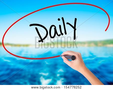 Woman Hand Writing Daily With A Marker Over Transparent Board