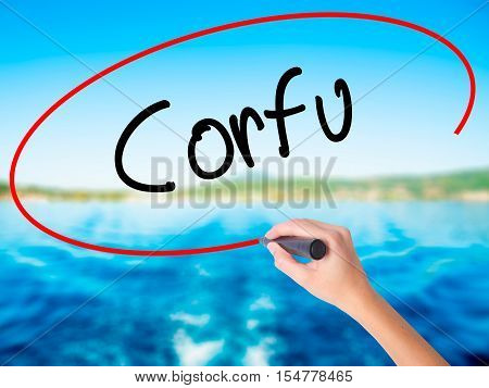 Woman Hand Writing Corfu With A Marker Over Transparent Board