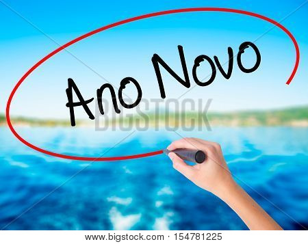 """Woman Hand Writing """"ano Novo"""" (in Portuguese: New Year) With A Marker Over Transparent Boa"""