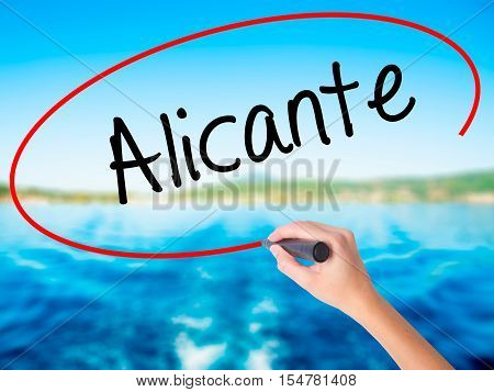 Woman Hand Writing Alicante  With A Marker Over Transparent Board