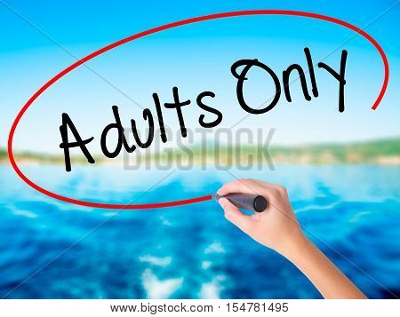 Woman Hand Writing Adults Only With A Marker Over Transparent Board