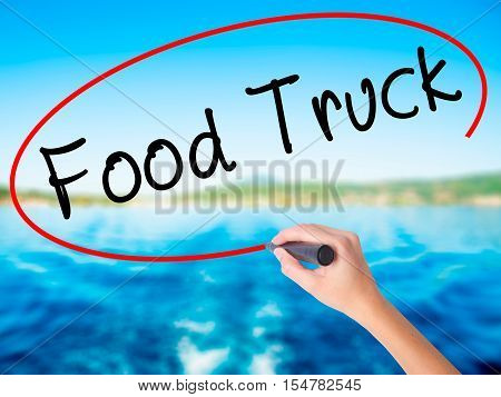 Woman Hand Writing Food Truck With A Marker Over Transparent Board