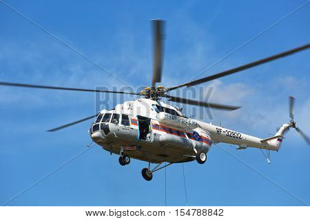 RUSSIA NOGINSK - AUGUST 7 2015: The helicopter Mi -BTMVB1 in the sky on doctrines of rescuers of Ministry of Emergency Situations of Russia.