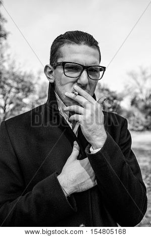 handsome guy in sun glasses sexy smokes