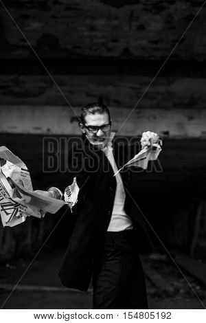 incredibly handsome guy with glasses aggressively tearing paper