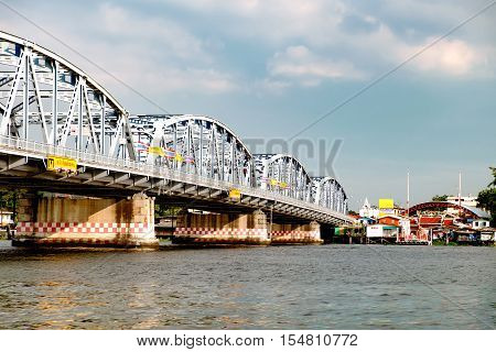 Bangkok, Thailand - December 9, 2015: Krung Thon Bridge is a bridge over the Chao Phraya River. It has 6 spans and consists of a steel superstructure resting on concrete piers.