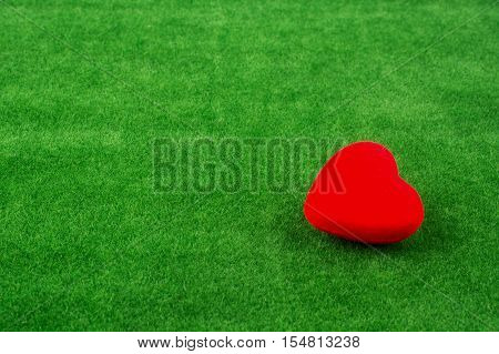 Red Heart Shape Icon On Grass