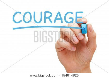 Hand writing Courage with blue marker on transparent wipe board.