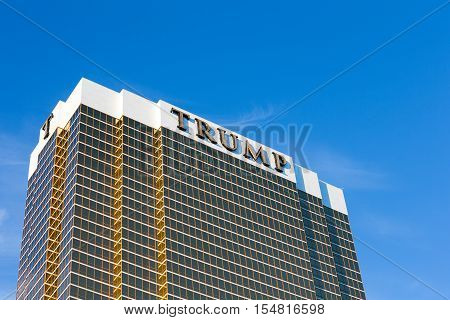 Las Vegas USA - October 26 2016: Trump International Hotel in Las Vegas NV set against a dramatic blue sky. Named for US real estate developer and politician Donald Trump the 64-story luxury property's exterior windows are gilded with 24-carat gold.