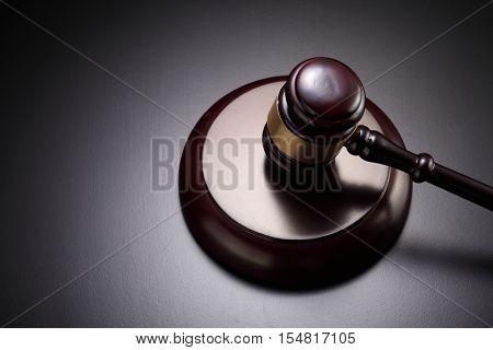 gavel hammer on the black background