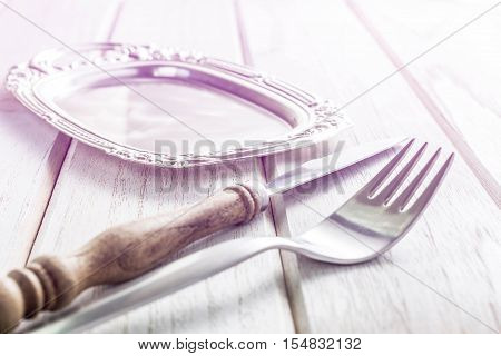 old fork and knife on white wooden table Vintage stye.