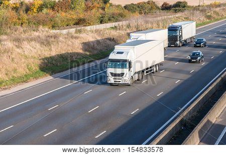 Three lorries on the motorway. Road traffic
