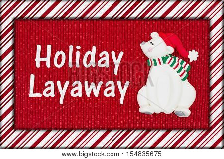 Christmas Holiday Layaway message Red shiny fabric with a candy cane border and a Santa polar bear with text Holiday Layaway 3D Illustration