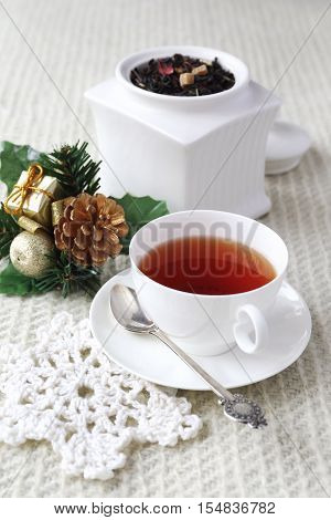 New Year tea drink: Flavored black tea in white porcelain dish