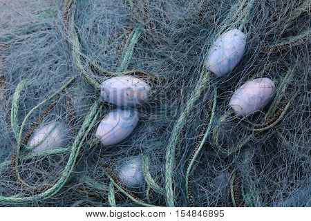 Blue fishing net and buoys used for fishing cod