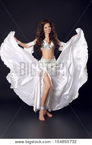 Beautiful Arabian Bellydancer Sexy Woman In Bellydance White Costume Over Black Studio Background. S