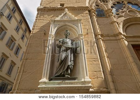 FLORENCE, ITALY - SEPTEMBER 2016 : Statue of Saint Matthew (Guild of the Money Changers and Lenders) by Lorenzo Ghiberti, Orsanmichele church exterior niche in Florence, Italy on September 21, 2016