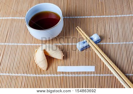 Fortune Cookie With Slip And Chopsticks And Tea